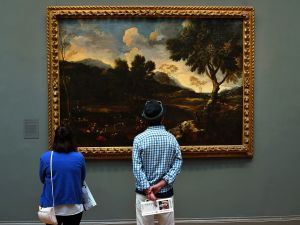 People look at paintings in the European Wing at the Metropolitan Museum of Art on May 31, 2013 in New York City. Many New Yorkers and tourists alike flocked indoors as temperatures reached into the 90's in New York City and parts of the northeast. (Photo by Spencer Platt/Getty Images)