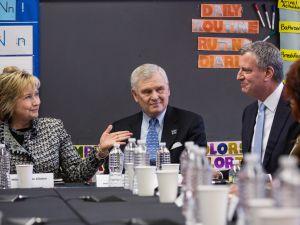 Former Secretary of State Hillary Clinton, left, meets with Mayor Bill de Blasio last year ((Photo: Andrew Burton/Getty Images)