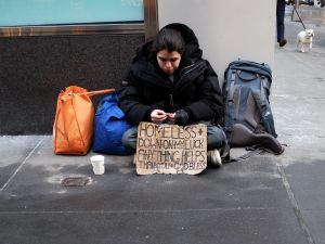 A homeless woman begs for help on the street (Photo: Jewel Samad for AFP/Getty Images)