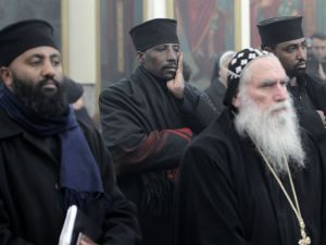 Egyptian Coptic Christian pilgrims pray in the Church of the Holy Sepulchre in Jerusalem's Old City on February 18, 2015, for the 21 Egyptian Coptic Christians beheaded by the Islamic State. (AHMAD GHARABLI/AFP/Getty Images)