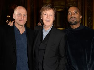 Woody Harrelson, Paul McCartney and Kanye West at the Stella McCartney show (Photo: Getty).