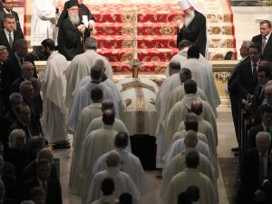 Members of the clergy touch the casket of Cardinal Edward Egan as they process into St. Patrick's Cathedral during a funeral mass March 10, 2015 in New York City. Egan, who led the New York Archdiocese for nearly a decade died March 5, at age 82. (Photo: Chad Rachman-Pool/Getty Images)