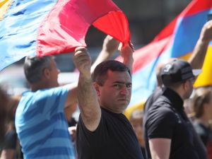 A man carries an Armenian flag during a march on the 99th anniversary of the Armenian Genocide, calling for recognition and reparations, on April 24, 2014 in Los Angeles, California. Relations between Turkey and Armenia, a former Soviet republic, remain split over the issue of genocide which, according to Western historians, resulted in the massacre of as many as 1.5 million Armenians and eviction of 500,000 others from land occupied by their ancestors for 2,500 years. Earlier this month, the Republic of Turkey condemned a U.S. Senate committee resolution branding the massacre of Armenians by Ottoman forces during World War One as genocide and warned that such a step could harm Turkish-American ties. (Photo by David McNew/Getty Images)