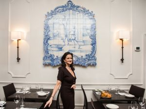 Ms. Farkas with a Portuguese tile mural in her restaurant (Photo: Emily Assiran/New York Observer).