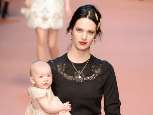 A model with a baby on the Dolce & Gabbana runway (Photo: Getty).