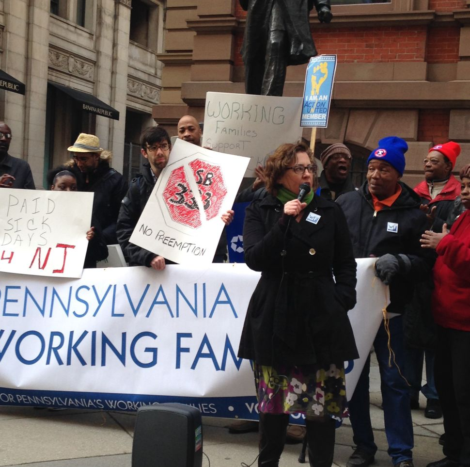 Awaiting Christie's arrival, paid sick leave advocates protest outside Philly's Union League
