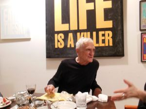 John Giorno, with one of his works, in the dining room of the Bunker. (Photo by Paul Laster)