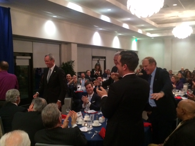 Va. Gov. McAuliffe makes N.J. Dems stand up, in more ways than one