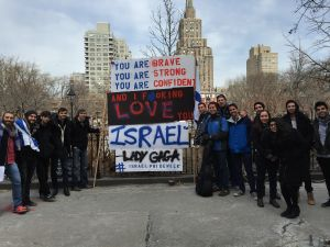 Outside Washington Square Park, NYU students are rallying against Israel Apartheid Week, displaying an inspirational quote from Lady Gaga (Shmuley Biotech/New York Observer)