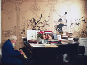 Al Hirschfeld photographed by Jill Krementz on December 4th, 1971, playing the piano in his living room. The house, with mural intact, was sold by his widow after she married Mr. Cullman and moved to Park Avenue. (Photo: © Jill Krementz)