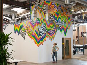 Jen Stark with her mural for Facebook's Menlo Park headquarters. (Photo: courtesy the artist)