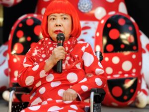 Japanese avant-garde artist Yayoi Kusama answers questions during a press preview for an 32-hour art event at Roppongi shopping district in Tokyo on March 22, 2012. (Photo credit: )