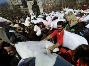 People hit each other with pillows as they take part in the world's annual Pillow Fight Day in Washington Square Park in New York. (Photo: Timothy A. Clary, Getty Images)