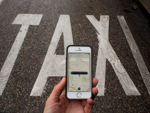 In this photo illustration the smart phone taxi app 'Uber' shows how to select a pick up location next to a taxi lane on October 14, 2014 in Madrid, Spain. (Pablo Blazquez Dominguez/Getty Images)