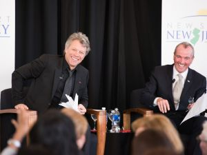 A couple ordinary middle class guys. Jon Bon Jovi (L) and Philip Murphy speak at the Middle Class Advocacy Group Summit on November 10, 2014 in Newark. (Dave Kotinsky/Getty Images)