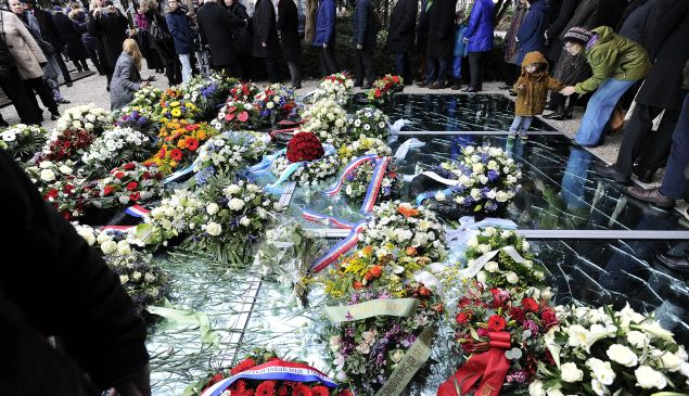 Flowers are laid at the Auschwitz monument in the Wertheimpark in Amsterdam, on January 25, 2015, as part of the International Holocaust Remembrance Day (Yom HaShoah) which will be held on January 27. AFP PHOTO / ANP / EVERT ELZINGA ==NETHERLANDS OUT== (Photo credit should read EVERT ELZINGA/AFP/Getty Images)