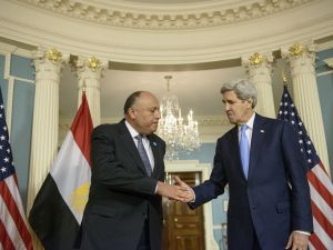 Egypt Minister of Foreign Affairs Sameh Shoukry (L) and US Secretary of State John Kerry shake hands after making statements to the press during the White House Summit on Countering Violent Extremism at the US State Department February 19, 2015 in Washington, DC. AFP PHOTO/BRENDAN SMIALOWSKI (Photo credit should read BRENDAN SMIALOWSKI/AFP/Getty Images)