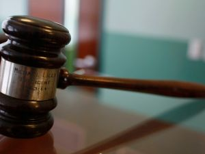A judges gavel rests on top of a desk in the courtroom of the newly opened Black Police Precinct and Courthouse Museum February 3, 2009 in Miami, Florida. The museum is located in the only known structure in the nation that was designed, devoted to and operated as a separate station house and municipal court for African-Americans. In September 1944, the first black patrolmen were sworn in as emergency policemen to enforce the law in what was then called the 'Central Negro District.' The precinct building opened in May 1950 to provide a station house for the black policemen and a courtroom for black judges in which to adjudicate black defendants. The building operated from 1950 until its closing in 1963. (Photo by Joe Raedle/Getty Images)