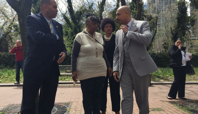 Congressman Hakeem Jeffries stands with Gwen Carr, the mother of Eric Garner, and Cynthia Davis and Kirsten John Foy of the National Action Network before today's announcement.