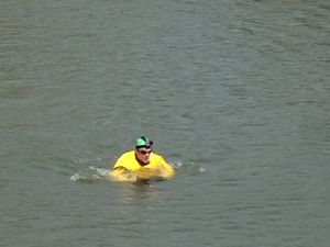 Christopher Swain swims the Gowanus Canal for Earth Day (Photo: the Observer/Aisling Brennan)