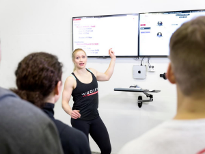 Wodify replaces the whiteboards commonly found in CrossFit gyms with TV screens. (Photo: Wodify)