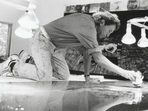 Robert Rauschenberg working on a metal painting in his Laika Lane studio, Captiva, Florida, (1989). (Courtesy Rauschenberg Foundation)