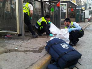 Ultra Orthodox ZAKA volunteers clean up at the scene after an explosion near a bus stop March 23, 2011 in central Jerusalem, Israel. (Photo: ZAKA via Getty Images)
