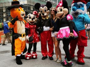 Costumed street performers pose with tourists for tips in Times Square on July 28, 2014 in New York City. (Photo: Spencer Platt/Getty Images)