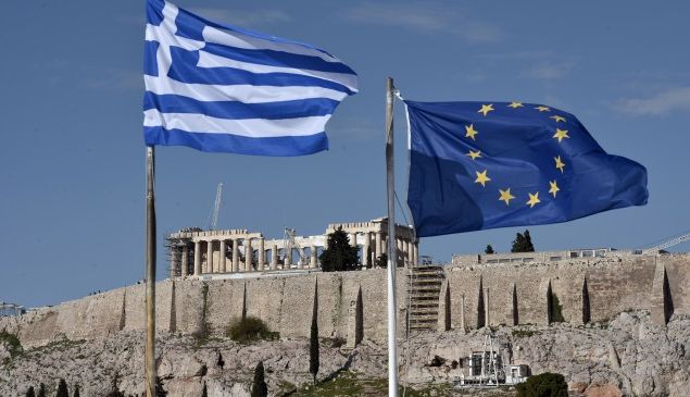 The Greek and EU flags flutter in front of the ancient Acropolis hill in Athens on January 15, 2015. Before snap elections were unexpectedly called in Greece on January 25, the troubled country was expected to finally limp out of recession after six painful years in the red. Now, with a clear electoral result far from certain, Greece's long-suffering business community fears that any chance of a tentative recovery will be delayed -- if not killed off outright -- by a damaging political stalemate. AFP PHOTO / LOUISA GOULIAMAKI (Photo credit should read LOUISA GOULIAMAKI/AFP/Getty Images)