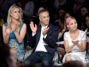 Nicky Hilton, Francisco Costa, and Nicole Richie at the Future of Fashion Runway Show. (Photo: Getty)