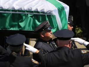 The casket for fallen New York City police officer Brian Moore is brought into a Long Island church on May 8, 2015 in Seaford, New York. (Photo by Spencer Platt/Getty Images)