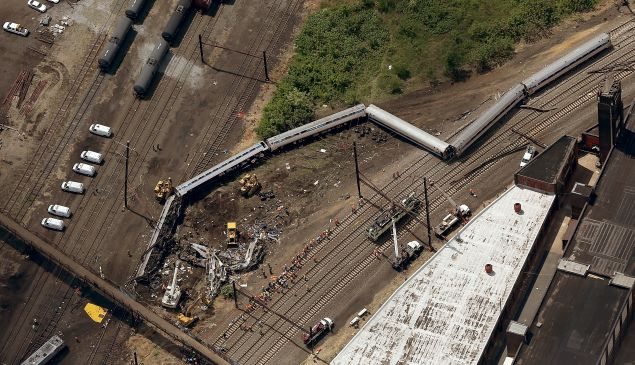 Investigators and first responders work near the wreckage of Amtrak Northeast Regional Train 188, from Washington to New York, that derailed yesterday May 13, 2015 in north Philadelphia, Pennsylvania. At least six people were killed and more than 200 others were injured in the crash. (Photo: Win McNamee/Getty Images)