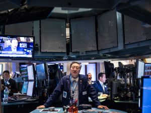 NEW YORK, NY - MAY 15: Traders work on the floor of the New York Stock Exchange during the morning of May 15, 2015 in New York City. The Dow Jones Industrial Average was slightly down in morning trading after it closed near its record high yesterday. (Photo by Andrew Burton/Getty Images)