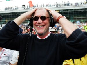 INDIANAPOLIS, IN - MAY 30: David Letterman, co-owner of the #15 Rahal-Letterman Argent/Pioneer G Force Honda of Buddy Rice smiles when the rains started to fall to cause the race to be shortened and win the 88th running of the Indianapolis 500 part of the IRL IndyCar Series on May 30, 2004 at the Indianapolis Motor Speedway in Indianapolis, Indiana.(Photo by Robert Laberge/Getty Images)