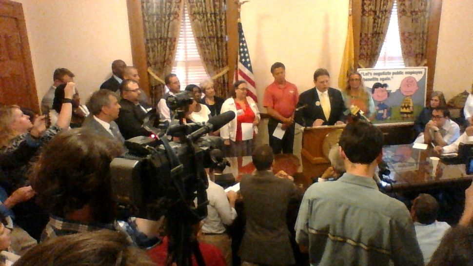Heading into budget vote, Dems join union leaders in sounding battle cry over pensions