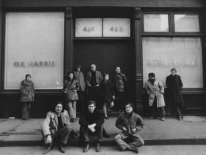 Art dealer and Director of OK Harris Gallery Ivan Karp poses with OK Harris artists for a portrait in February 1970 in front of OK Harris Gallery in Soho, New York City, New York. In the doorway, starting second from left is artist Duane Hanson, Ms. Marilyn Karp, and gallerist Ivan Karp. (Photo by David Gahr/Getty Images)