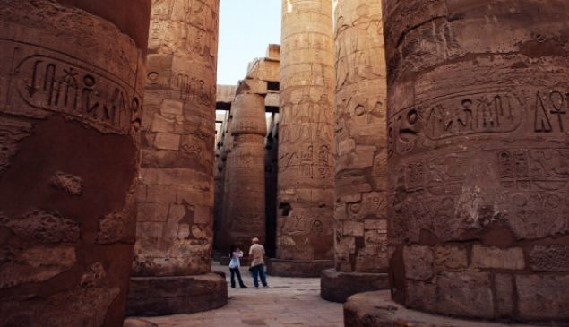 A couple of tourists walk through the Karnak Temple in 2013 in Luxor, Egypt.