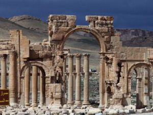 Syrian citizens walking in the ancient city of Palmyra. (AFP Photo: Joseph Eid/AFP/Getty Images)