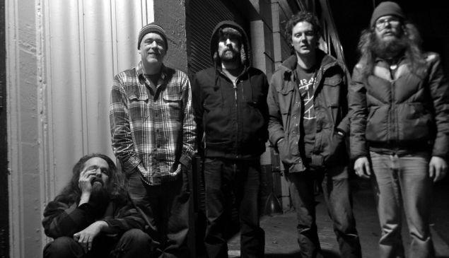 Begrudging indie rock band begrudgingly takes begrudging band promo photo.