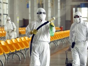 "Workers disinfect the waiting room of Beijing railway station in the fight against SARS, 25th May 2003. Beijing has seen a ""notable downward"" trend in the disease known as Severe Acute Respiritory Syndrome (SARS) cases over the past week, officials said, expressing confidence the capital can beat the outbreak but warn of a new challenge as people return to normal routines. AFP PHOTO/Peter PARKS (Photo credit should read PETER PARKS/AFP/GettyImages)"