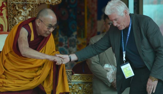 US actor Richard Gere (R) shakes hands with Tibetan spiritual leader, the Dalai Lama to greet him on his 79th birthday at Choglamsar, about 10 kms from Leh, Ladakh on July 6, 2014. The Dalai Lama (STR/AFP/Getty Images)