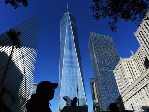 People walk past the construction site of the One World Trade Center in New York. (Photo:JEWEL SAMAD/AFP/Getty Images)