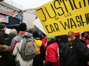 Protesters at a rally at a Brooklyn car wash (Photo by Spencer Platt/Getty Images).