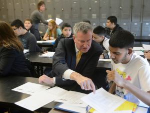 Mayor Bill de Blasio talks with a high school student