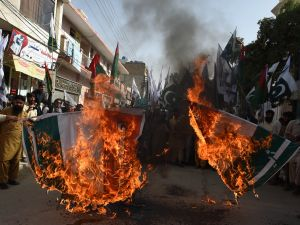 Pakistani activists from the banned organisation Jamaat-ud-Dawa (JuD) burn an Indian flag during a protest in Quetta on June 12, 2015. Pakistan has strongly reacted to comments made by Indian Prime Minister Narendra Modi that reportedly acknowledged Indian troops had a role in the war that created Bangladesh which was part of Pakistan until 1971 when separtisits won independence after a war. Pakistani parliament on June 11, 2015, passed unanimous resolutions strongly condemning recent provocative statements made by Indian leaders, including the threat of attacks against Pakistani territory. AFP PHOTO / BANARAS KHAN (Photo credit should read BANARAS KHAN/AFP/Getty Images)