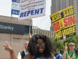 Pride celebrants and religious protesters in St. Louis, Missouri on June 28, 2015. (Photo/Michael B. Thomas/AFP/Getty Images)