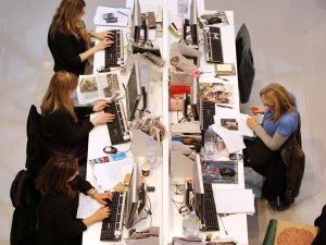 Production staff on the weekly fashion magazine, Grazia edit the magazine in a temporary office inside the Westfield shopping centre on November 3, 2008 in London. (Photo: Oli Scarff/Getty Images)