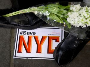 Members of #SaveNYC and loyal customers stood outside Louis Shoe Rebuilders today to raise awareness of the changing fabric of New York's landscape. (Photo: Giulia Olsson/New York Observer)