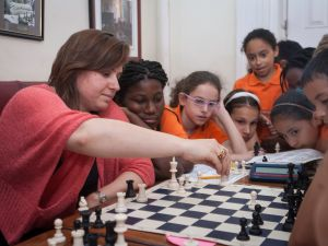 Grandmaster Judit Polar with Success Academy chess scholars at the Marshall Club. (Photo by Ari Mintz)