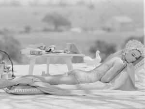 British actress Audrey Hepburn in swimsuit by the swimming pool on location in St Tropez during filming of Two For The Road. (Photo by Terry O'Neill/Getty Images)